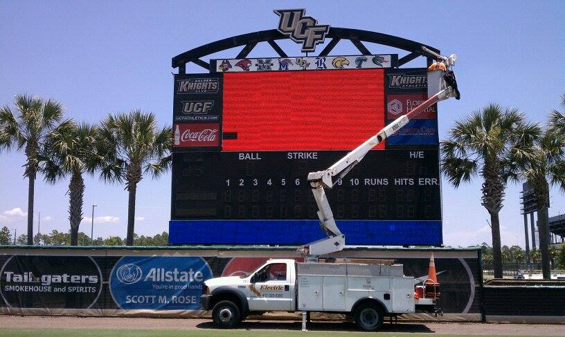Using a Bucket Truck to Repair UCF Baseball Scoreboard Sign